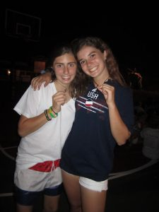 Eliza Kagan as a Bunk One Camper at Lake Bryn Mawr Camp, showing off her angel necklace with a bunkmate
